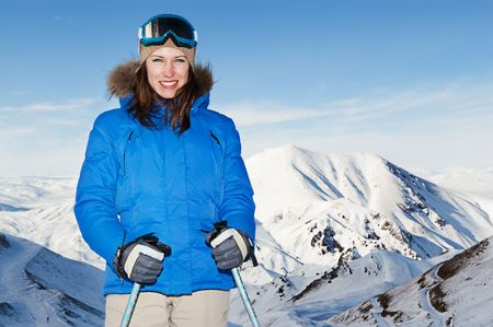 attractive woman posing against beautiful mountains
