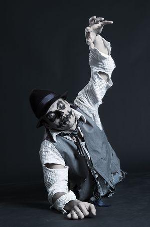 deadman: crawling zombie over dark background