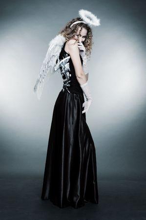 cute angel against grey background photo