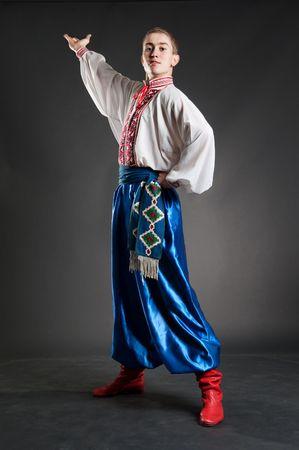 handsome ukrainian cossack over dark background photo