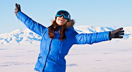 attractive happy woman against snowy mountains photo