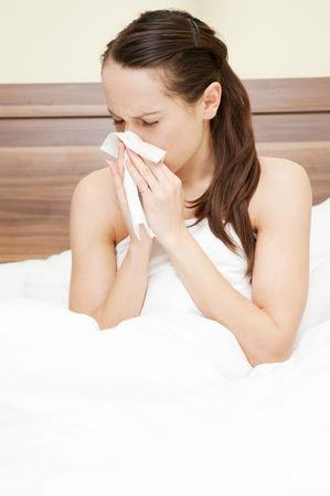 young woman in the bed with flu photo