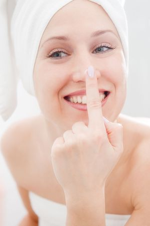 beautiful woman taking care of her face Stock Photo - 4209953