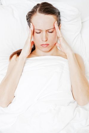 afflict: tired woman with migraine lying in the bed