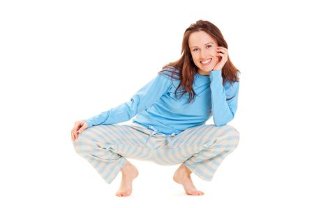 happy woman in blue pyjamas sitting on the floor photo