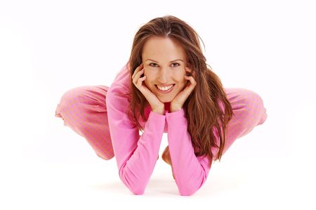 happy woman in pink pyjamas against white background photo