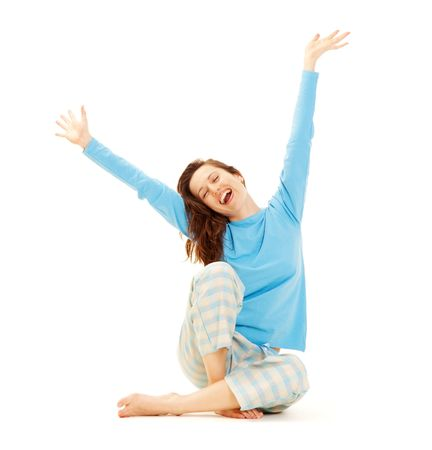 happy young woman in blue pyjamas isolated on white background photo