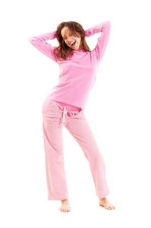 happy young woman in pyjamas at the morning photo