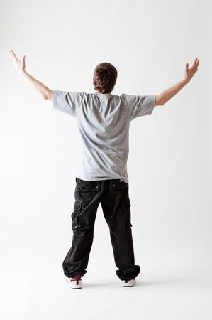 roughneck: back view of teenager in grey T-shirt and black jeans