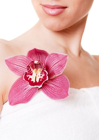 close-up portrait of woman with orchid against white background Stock Photo - 4339504