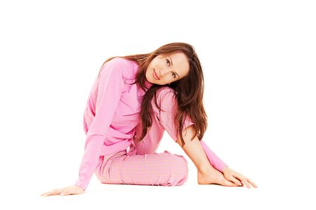 cute brunette in pink pajamas isolated on white photo