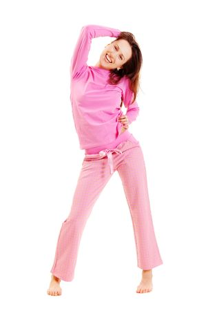 cute smiley woman in pink pyjamas isolated on white photo
