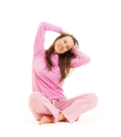 happy young woman in pink pajamas sitting on the floor photo