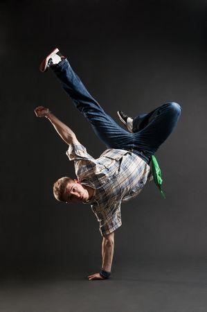 Rowdy: breakdancer standing in cool freeze against dark background