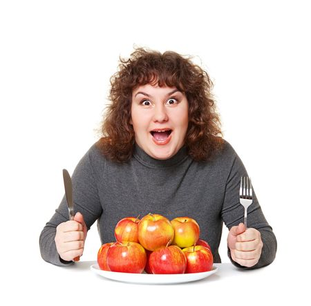 emotional woman: emotional woman with apples against white background