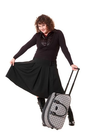 smiley woman with luggage against white background photo