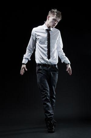 stylish young man against dark background photo