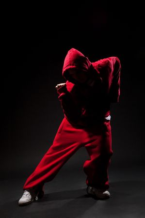 roughneck: urban dancer moving in darkness Stock Photo