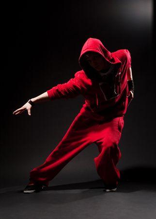 Rowdy: stylish dancer in red over dark background Stock Photo