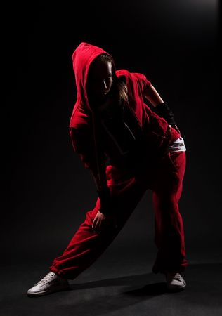 roughneck: stylish hip hop girl in red over dark background