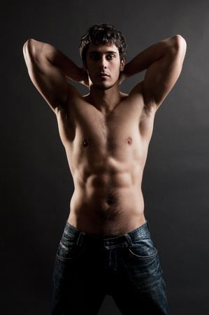 portrait of handsome muscleman against dark background Stock Photo - 4627486