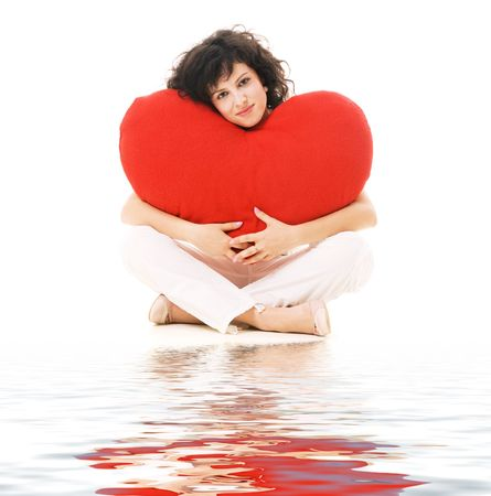 yoga pillows: happy young woman with big red heart sitting against white background
