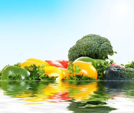 improbable island from fresh vegetables under blue sky photo