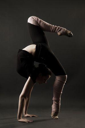 lovely gymnast against dark background photo