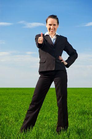 prosperous: prosperous businesswoman showing thumbs up Stock Photo