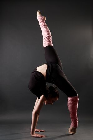 contortionist: young woman showing beautiful gymnastic pose