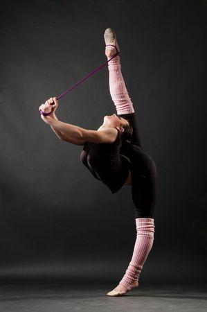graceful dancer against dark background photo
