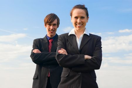 two happy colleagues against blue sky photo