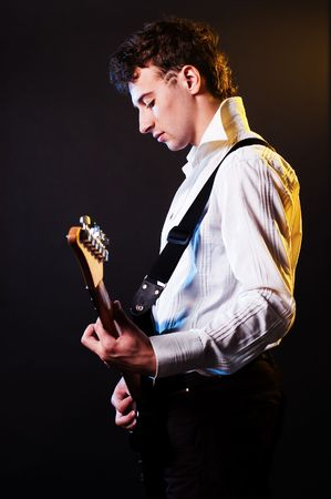 showbusiness: guitarist playing at the stage
