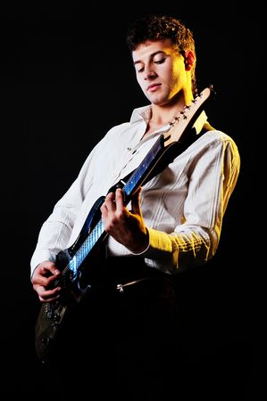 showbusiness: musician playing the guitar at the stage