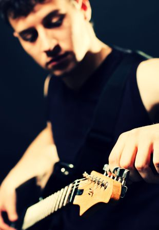 starlet: musician tune up the guitar at the stage