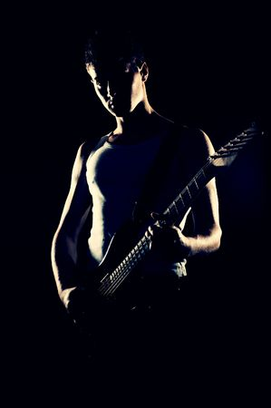 showbusiness: silhouette of rock musician with guitar  Stock Photo
