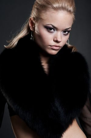 portrait of beautiful model in black fur photo