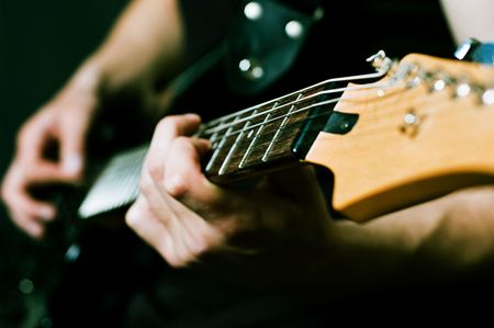 close-up of man hands on guitar Stock Photo - 4999824