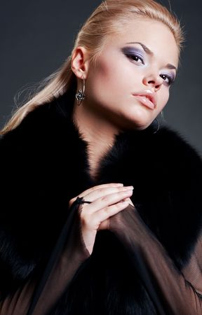 portrait of sexy model in black fur photo