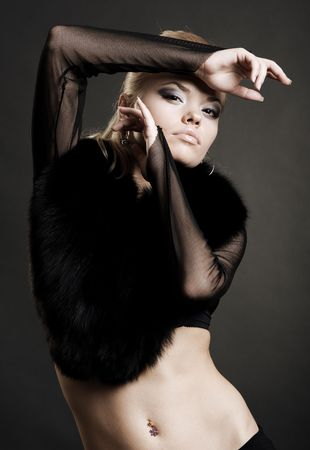 portrait of sexy woman in black fur photo