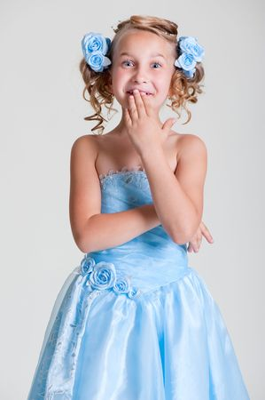 portrait of surprised girl in blue dress photo