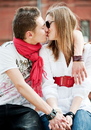 love kissing: young trendy couple in love kissing each other Stock Photo