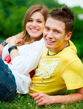 young happy couple relaxing at the park Stock Photo - 5075468