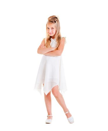 beautiful small girl in white dress posing  Stock Photo - 5153176