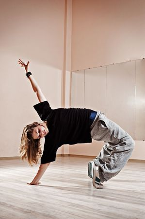breakdancer standing in bridge. photo in dance studio photo