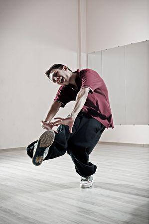 motioning: emotional dancer motioning in dance studio