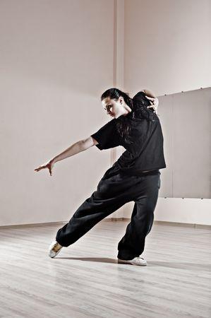 hip-hop girl dancing in dance studio photo