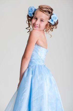 portrait of cutie girl in blue dress photo