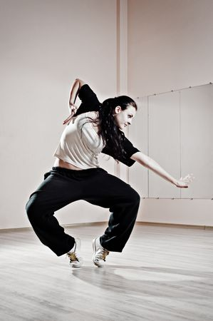 young pretty dancer in motion. photo in dance studio photo