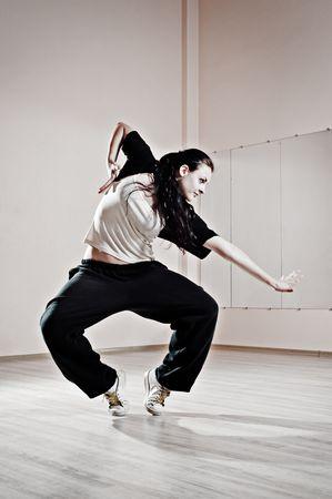 young pretty dancer in motion. photo in dance studio photo